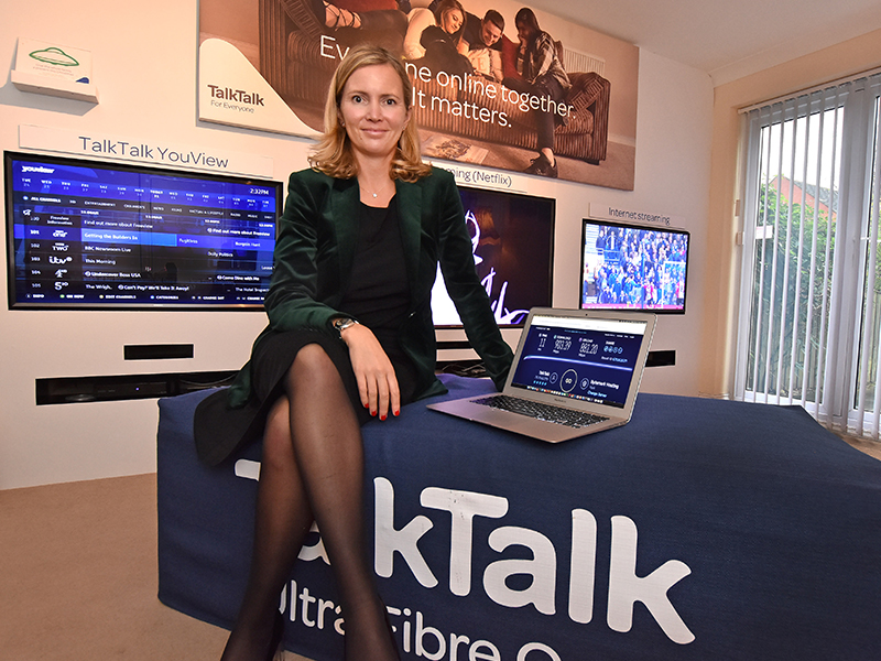 TalkTalk CEO Tristia Harrison sat with TalkTalk logo and laptop