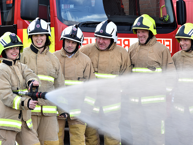 TalkTalk's Marketing Managers Helen Fletcher and Michelle McCarthy dressed as fire officers with York fire station team