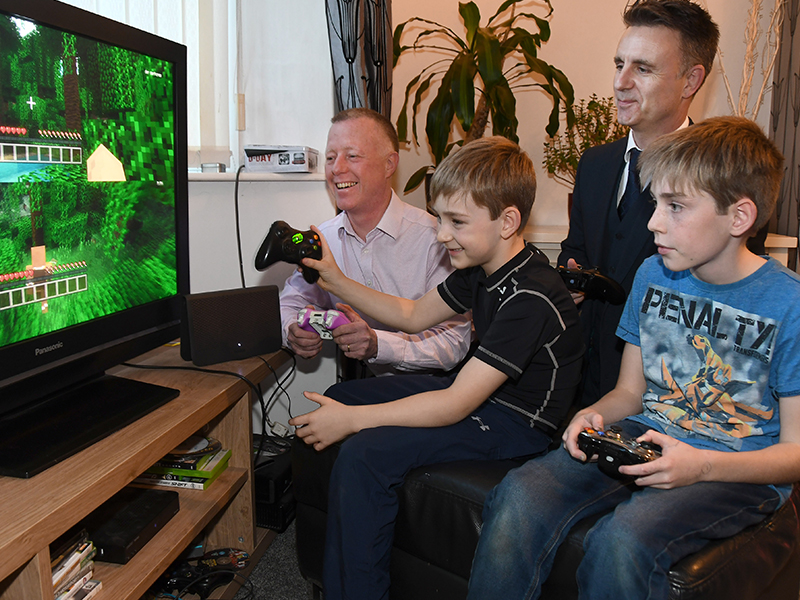 Paul Crane from TalkTalk playing Xbox with a family